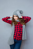Happy woman with hat and scarf Stock Photography