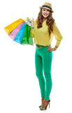 Happy woman in hat with shopping bags on white background Royalty Free Stock Image