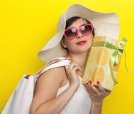 Happy woman in hat and sun glasses Stock Photo