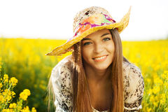 Happy woman in a hat of wildflowers Stock Photo