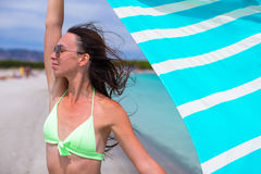Happy woman have fun with beach towel and very Stock Image