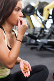 Happy woman having a break from exercising in health club Stock Photos
