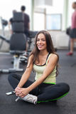 Happy woman having a break from exercising in health club Royalty Free Stock Photography