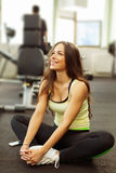 Happy woman having a break from exercising in health club Stock Image