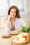 Happy woman having breakfast Stock Photography