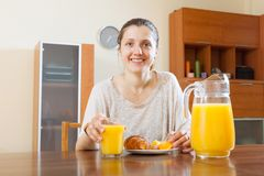 Happy  woman having breakfast Stock Image