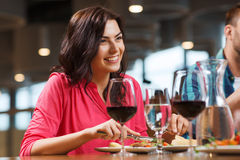 Happy woman having dinner at restaurant Royalty Free Stock Image