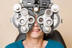 Happy Woman Having An Eye Test Royalty Free Stock Image