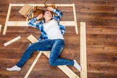 Happy woman having fun assembling furniture. Royalty Free Stock Image