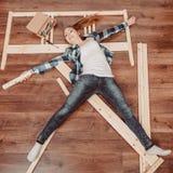 Happy woman having fun assembling furniture. Stock Photos