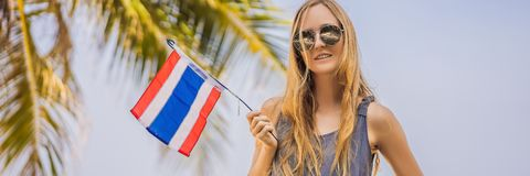 Happy woman having fun at the beach with Thailand flag. Beautiful girl enjoying travel to Asia BANNER, LONG FORMAT stock photos