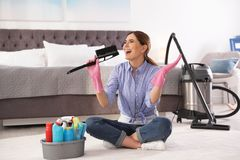 Happy woman having fun while cleaning royalty free stock photography