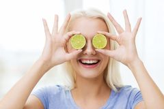 Happy woman having fun covering eyes with lime Stock Photos