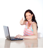 Happy woman having fun with laptop and thumb up Royalty Free Stock Photos