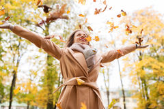 Happy woman having fun with leaves in autumn park Stock Photography