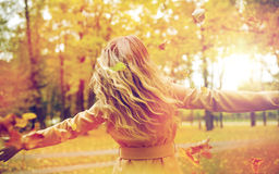 Happy woman having fun with leaves in autumn park Royalty Free Stock Images