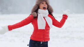 Happy woman having fun outdoors in winter stock footage