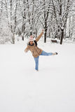 Happy woman having fun in the snow Stock Image