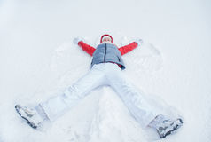 Happy woman having fun on snow in winter Stock Image