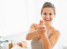 Happy woman having fun time while applying cream in bathroom Royalty Free Stock Photos