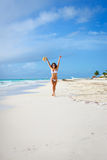 Happy woman having fun on tropical beach travel vacation Royalty Free Stock Photo