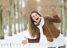 Happy woman having fun in winter outdoors Stock Images