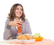 Happy woman having light breakfast Royalty Free Stock Photos