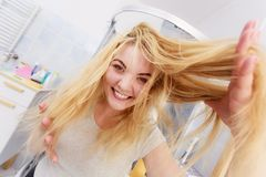 Woman with long blonde hair stock image
