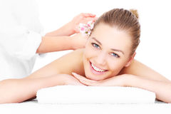 Happy woman having massage stock images