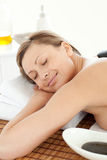 Happy woman having a massage with stones Royalty Free Stock Images