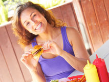 Happy Woman Having Mini Hamburger Royalty Free Stock Image