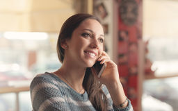 Happy woman having a phone call Royalty Free Stock Photography