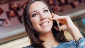 Happy woman having a phone call Stock Image