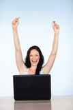 Happy woman having success with laptop Royalty Free Stock Photo