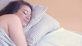 Happy woman sweet dreams rest cozy home bed. Happy woman having sweet dreams, resting at home, lying in her cozy bed with eyes closed, smiling stock video footage