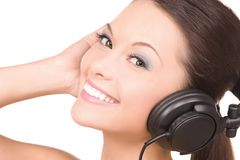 Happy woman in headphones Royalty Free Stock Photography