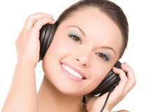 Happy woman in headphones Royalty Free Stock Images