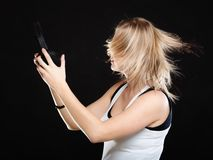 Happy woman with headphones in dancing motion Stock Images
