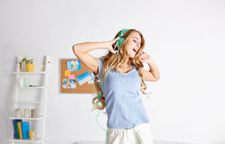 Happy woman in headphones ihaving fun at home Royalty Free Stock Photography
