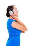 Happy woman in headphones listening music Stock Images