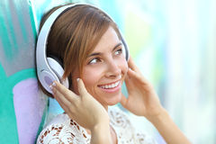 Happy woman with headphones listening to the music Royalty Free Stock Photography