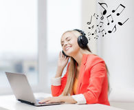 Happy woman with headphones listening to music Stock Photo
