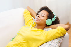 Happy woman with headphones listening to music Stock Images
