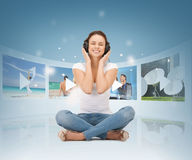 Happy woman with headphones Stock Photography
