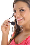 Happy woman with headset. Shot of a happy woman with headset Stock Images