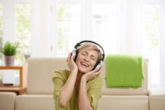 Happy woman with headset Royalty Free Stock Images