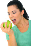 Happy Woman With Healthy Lifestyle. Young attractive woman eating green apple. isolated on white royalty free stock photography