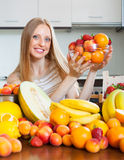 Happy woman with heap of various fruits Royalty Free Stock Photo