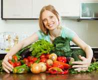Happy woman with heap of vegetables Royalty Free Stock Image