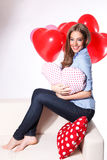 Happy woman with heart balloons Stock Photography